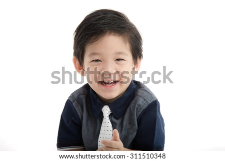 Close up happy little asian boy on white background isolated