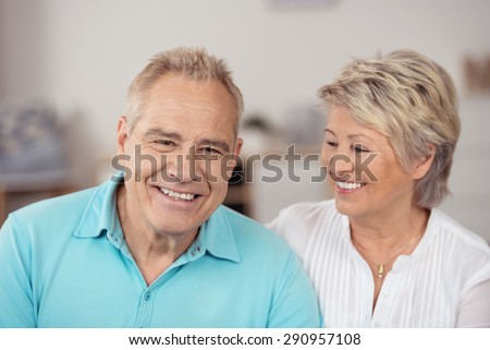 Close up Happy Portrait of Middle Aged Couple with Blond Hair, Showing Toothy Smiles on their Faces. - stock photo