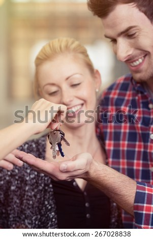 Close up Happy Romantic Young Couple Received Keys From a Woman Hand - stock photo