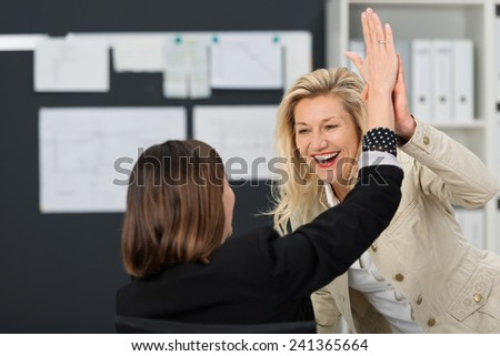 Close up Happy White Businesswoman Showing High Five Sign at the Office. - stock photo
