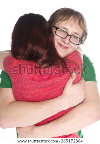 Close up Happy Young Boyfriend with Eyeglasses Hugging her Girlfriend So Close While Looking at the Camera, Isolated on White Background. - stock photo
