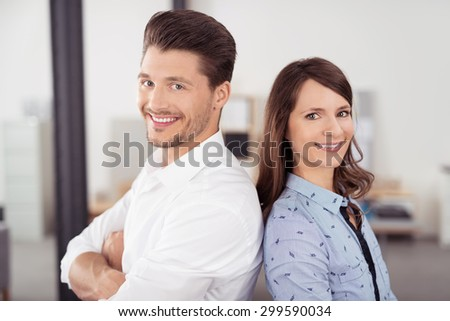Close up Happy Young Professional Couple In back to Back, Smiling at the Camera. - stock photo