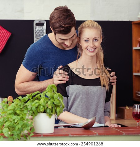 Close up Happy Young Sweethearts Cooking for Dinner at the Kitchen - stock photo