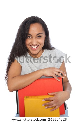 Close up Happy Young Woman Leaning on her Books While Looking at the Camera. Isolated on White Background. - stock photo