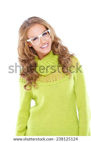 Close up Happy Young Woman with Long Wavy Blond Hair Wearing Trendy Yellow Green Knit Longs Sleeve Shirt and White Glasses. Isolated on White Background. - stock photo