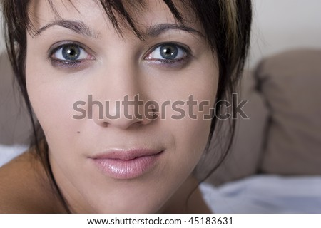 Close up head shot of a beautiful young woman. - stock photo