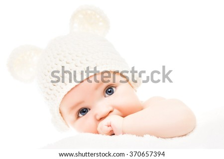 Close up head-shot of a caucasian baby boy,four months old baby looking at camera. - stock photo