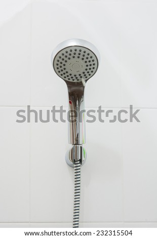 close up head shower on white wall background - stock photo