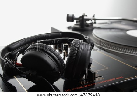 Close up headphone on the dj mixer in studio