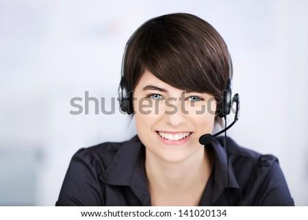 Close up headshot of beautiful Customer service representative - stock photo