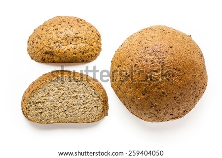 Close up Healthy Fresh Whole and Sliced Brown Wheat Bread Isolated on White Background.