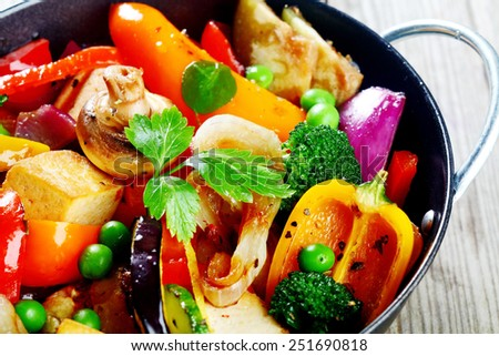 Close up Healthy Recipe on Cooking Pan with Tofu, Broccoli, Mushrooms, Beans and Spices. Served on Wooden Table. - stock photo