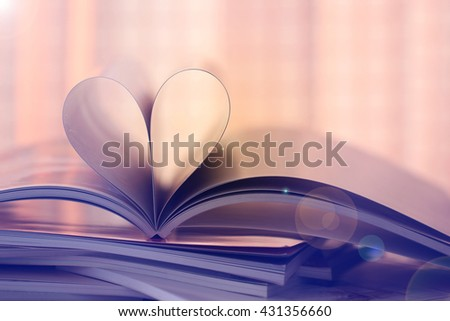 Close up Heart from magazine, Vintage color tone - stock photo