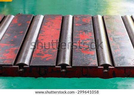 Close up heavy metal  rollers conveyor - stock photo