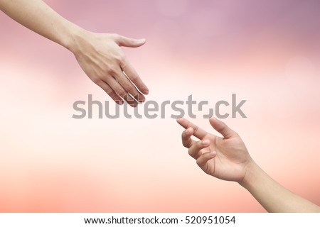 close up helping praying hands on blur beautiful sunrise sky background.support advocate.god give empower positive power safe living:medical heal people:friendship intimacy familiarity ideal:wish well