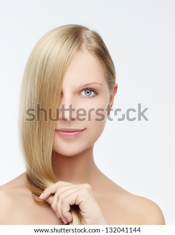 Close-up  hi key beauty portrait of a young beautiful woman with blond hair - stock photo