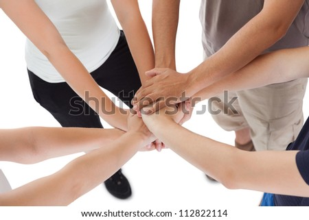 Close-up high angle view of a happy family holding hands - stock photo