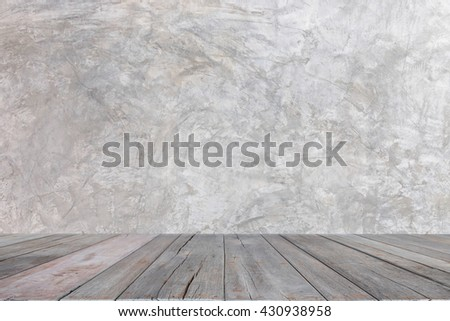 Close-up high quality gray concrete texture background against wood floor.