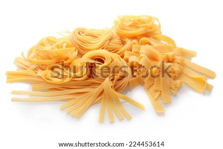 Close up Homemade Fresh Flat Italian Pasta on White Background. - stock photo