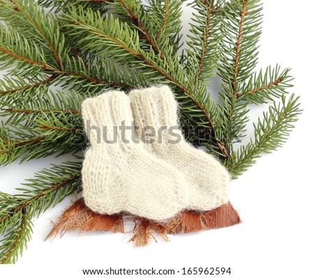 Close up homemade knitted woolen socks baby - stock photo