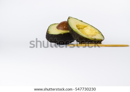 Close up Honey dripping on Avocado slice isolated on white - Healthy concept