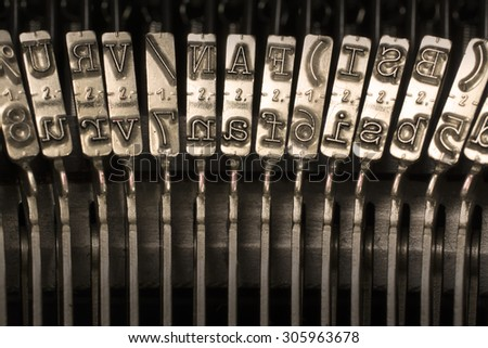 Close-up Horizontal Photograph of Used Metal Typebars - stock photo