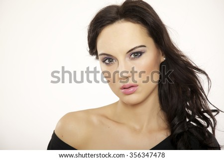 Close up horizontal portrait of a beautiful young adult sexy sensuality attractive pretty brunette woman isolated on white background - stock photo