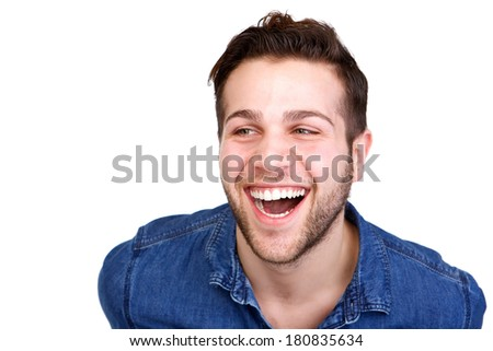 Close up horizontal portrait of a handsome young man laughing on isolated white background - stock photo