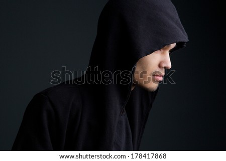 Close up horizontal portrait of a man with hooded sweatshirt  - stock photo