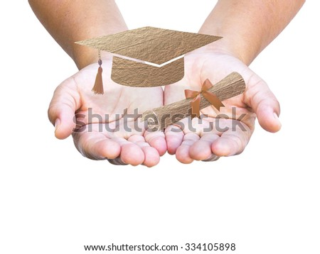 Close up human hand holding graduation cap and diploma scroll made of brown fabric texture isolated on white background. - stock photo