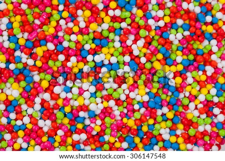 close up icing is colorful background of sugar small ball for food decoration - stock photo