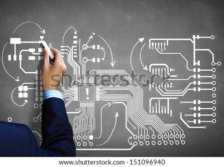 Close up image human hand drawing circuit board - stock photo