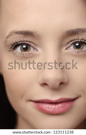 close up image of a attractive womans face looking at camera