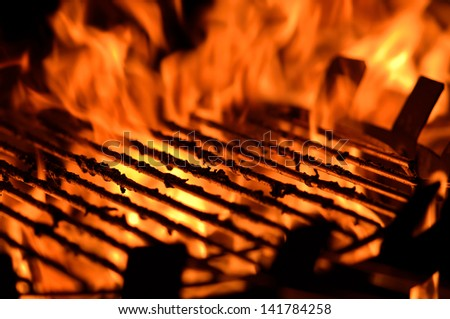 Close up image of a BBQ grill with flames - stock photo