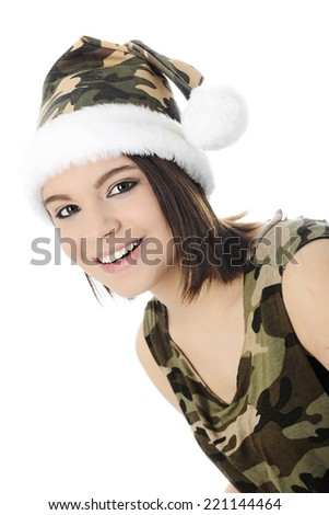 Close-up image of a beautiful teen girl dressed in a sleeveless camouflage shirt and Santa-style hat.  On a white background. - stock photo
