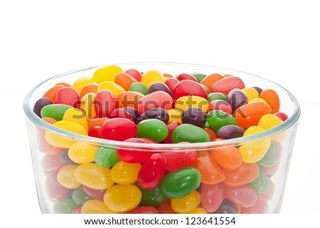 Close-up image of a container with colorful candies in a white background - stock photo