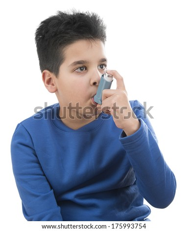 Close up image of a cute little boy using inhaler for asthma