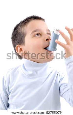 Close up image of a cute little boy using inhaler for asthma. White background MEDICAL related studio picture - stock photo