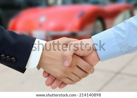 Close-up image of a firm handshake  after a successful deal of buying a car - stock photo