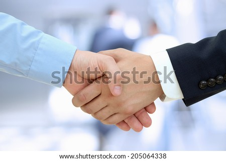 Close-up image of a firm handshake  between two colleagues isolated on a white background - stock photo