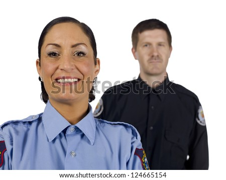 Close-up image of a happy policewoman with a policeman on her background - stock photo