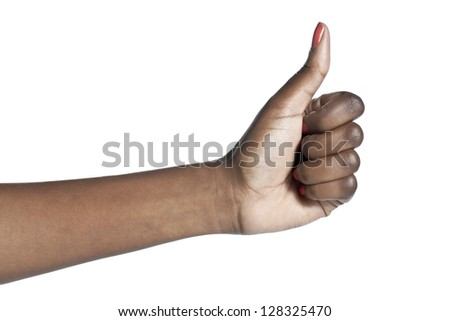 Close-up image of a human hand with an approved gesture over the white surface