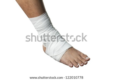 Close-up image of a human leg wrapped with white medicine bandage. - stock photo