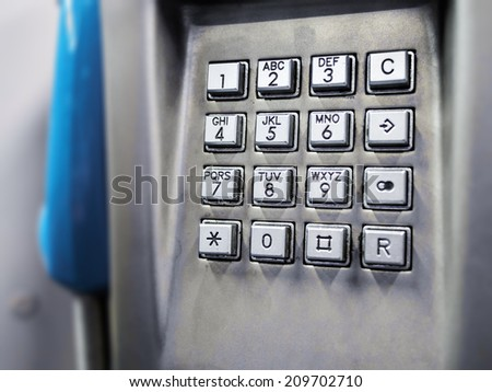 close up image of a keyboard of a public telephone