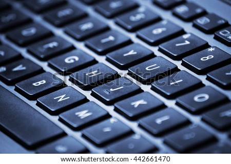 Close-up image of a laptop keyboard with shallow depth of field. - stock photo
