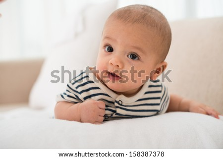 Close-up image of a little cute baby on the foreground