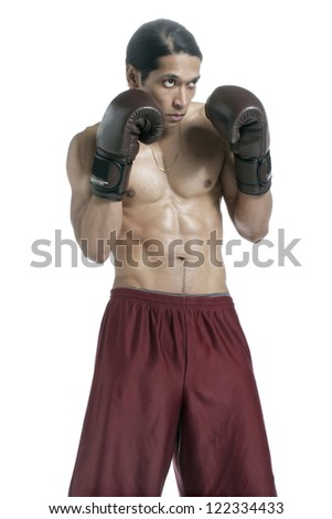 Close-up image of a muscular male boxer with a punching gesture isolated on a white surface