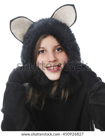 "Close-up image of a pretty young teen smiling at the viewer while dressed in a her black cat outfit and her ""paws"" supporting her head. On a white background."