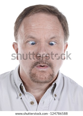 Close-up image of a senior man looking down with an eye crossed - stock photo