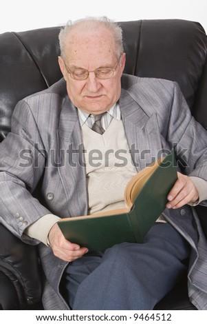 Close-up image of a senior man reading a book. - stock photo